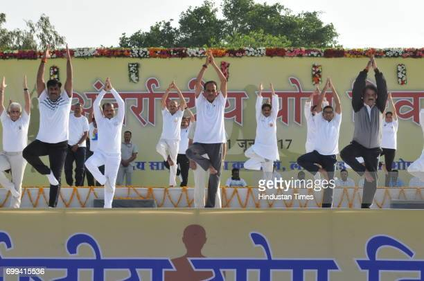 Madhya Pradesh chief minister Shivraj Singh Chouhan along with others performing yoga during state level International yoga day programme at Lal...