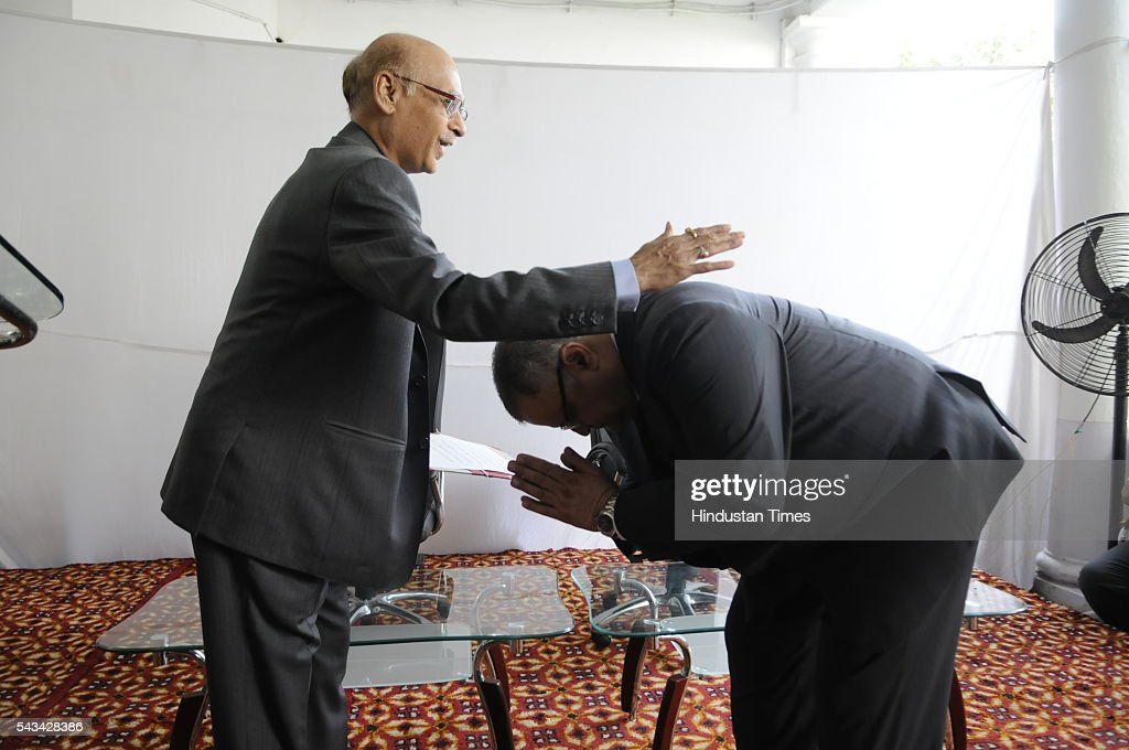 Madhya Pradesh Deputy Lokayukta UC Maheshwari seeking blessings of outgoing Lokayukta PP Naolekar after being administered oath of office on June 28, 2016 in Bhopal, India. In a rapid series of developments, Justice UC Maheshwari was on Tuesday administered the oath of office as Madhya Pradesh Up Lokayukta (the Lokayukta's Deputy) by the Lokayukta Justice PP Naolekar at a ceremony at the Lokayukta office in the evening. A few hours later, Justice PP Naolekar demitted office after completing 7 years in the post. Consequently, Justice UC Maheshwari would discharge the functions of Lokayukta till the time a new Lokayukta is appointed by the state government.