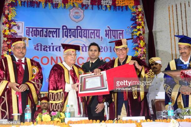 Madhya Pradesh Governor OP Kohli presenting the 'honorary degree D Sc' to former Union Minister and veteran BJP leader Murli Manohar Joshi during the...