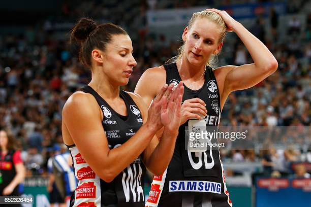 Madi Robinson of the Magpies and April Brandley of the Magpies walk from the court at half time during the round four Super Netball match between the...
