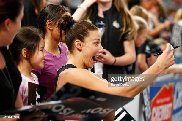 Madi Robinson of the Magpies poses for a selfie with fans after the round four Super Netball match between the Magpies and the Thunderbirds at...