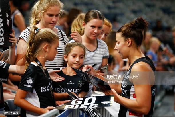 Madi Robinson of the Magpies signs autographs for fans after the round four Super Netball match between the Magpies and the Thunderbirds at Hisense...
