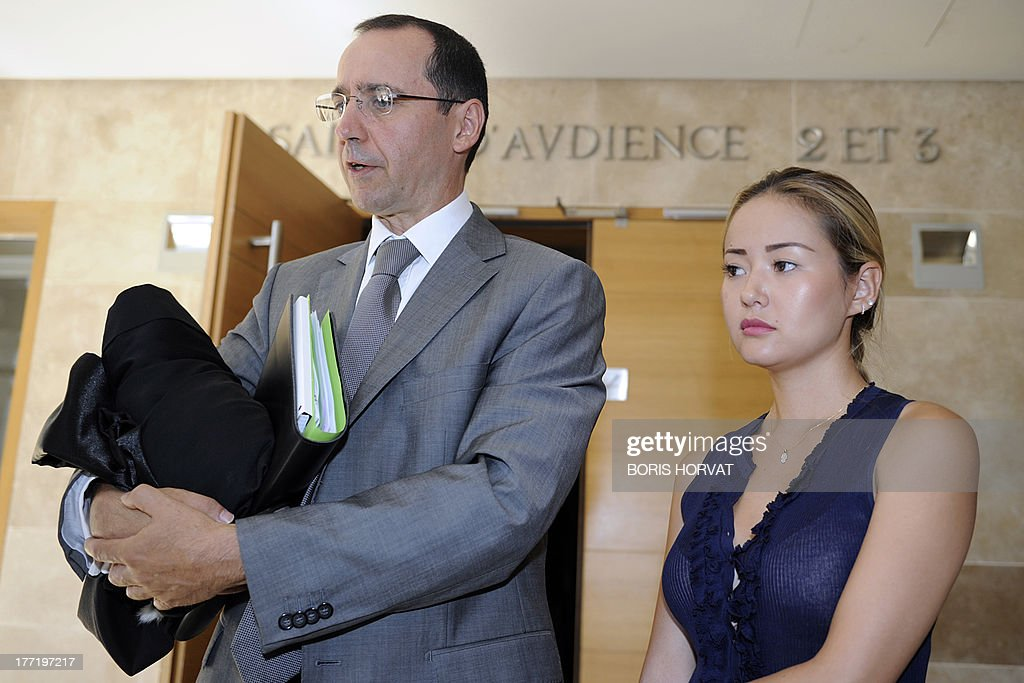 Madina Ablyazov, the daughter of dissident Kazakh oligarch Mukhtar Ablyazov, stands with her lawyer Bruno Rebstock, in Aix-en-Provence courthouse, Southern France, on August 22, 2013. Dissident Kazakh oligarch Mukhtar Ablyazov, accused at home of embezzling more than $5 billion, was told by a French judge on Thursday that he faced extradition, but his family vowed to fight an expulsion it said was politically motivated. The 50-year-old businessman, an outspoken critic of Kazakhstan's long-time leader Nursultan Nazarbayev, has been in custody in France since his arrest near the French Riviera resort of Cannes. AFP PHOTO / AFP-PHOTO BORIS HORVAT