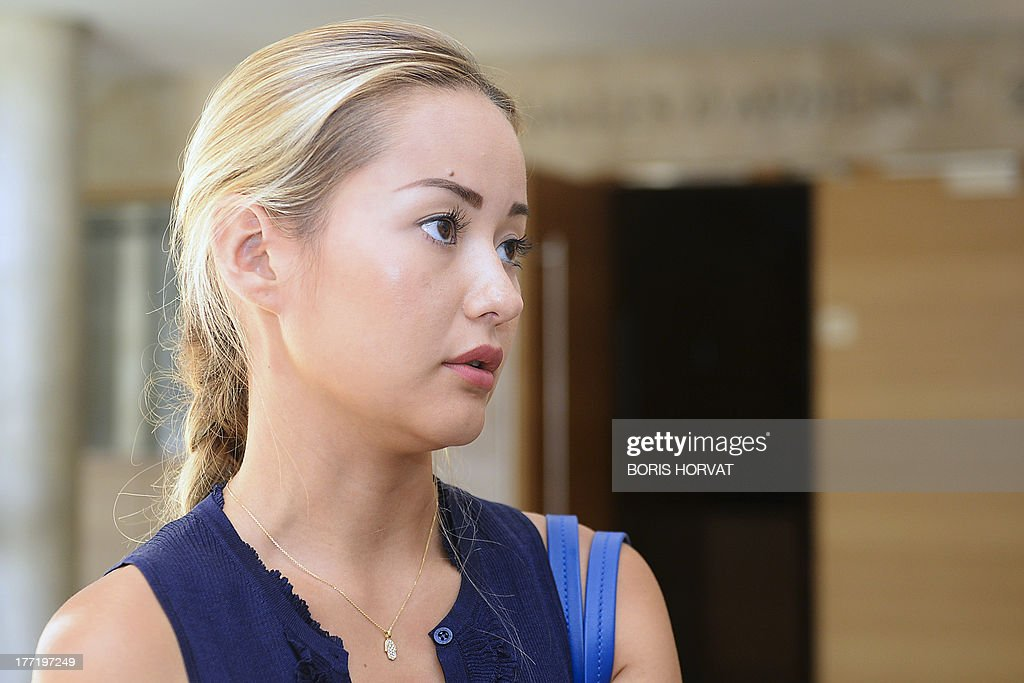 Madina Ablyazov, the daughter of dissident Kazakh oligarch Mukhtar Ablyazov, waits in a hallway of the courthouse, in Aix-en-Provence, Southern France, on August 22, 2013. Dissident Kazakh oligarch Mukhtar Ablyazov, accused at home of embezzling more than $5 billion, was told by a French judge on Thursday that he faced extradition, but his family vowed to fight an expulsion it said was politically motivated. The 50-year-old businessman, an outspoken critic of Kazakhstan's long-time leader Nursultan Nazarbayev, has been in custody in France since his arrest near the French Riviera resort of Cannes.