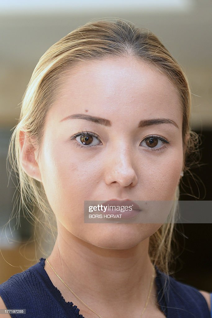 Madina Ablyazov,daughter of dissident Kazakh oligarch Mukhtar Ablyazov, waits in a hallway of the courthouse, in Aix-en-Provence, Southern France, on August 22, 2013. Dissident Kazakh oligarch Mukhtar Ablyazov, accused at home of embezzling more than $5 billion, was told by a French judge on Thursday that he faced extradition, but his family vowed to fight an expulsion it said was politically motivated. The 50-year-old businessman, an outspoken critic of Kazakhstan's long-time leader Nursultan Nazarbayev, has been in custody in France since his arrest near the French Riviera resort of Cannes. AFP PHOTO / AFP-PHOTO BORIS HORVAT