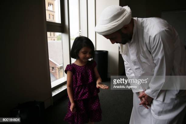 Madina daughter of NYU Islamic Center Imam Khalid Latif shows her Henna before EidulFitr a holiday celebrated by Muslims worldwide that marks the end...
