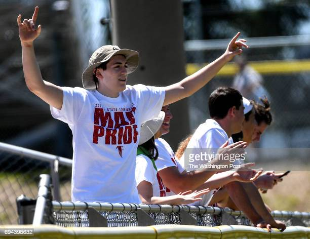Madion fan cheers after an RBI double during the Virginia 6A State Softball Semifinal game between Madison and Kellam at Westfield High School on...