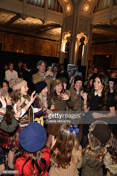 Madison Beer poses with models at the Ralph Lauren Fall 14 Children's Fashion Show in Support of Literacy at New York Public Library on May 19 2014...