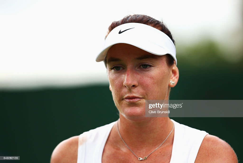 <a gi-track='captionPersonalityLinkClicked' href=/galleries/search?phrase=Madison+Brengle&family=editorial&specificpeople=4110556 ng-click='$event.stopPropagation()'>Madison Brengle</a> of The United States looks on during the Ladies Singles first round match against Kurumi Nara of Japan on day one of the Wimbledon Lawn Tennis Championships at the All England Lawn Tennis and Croquet Club on June 27th, 2016 in London, England.