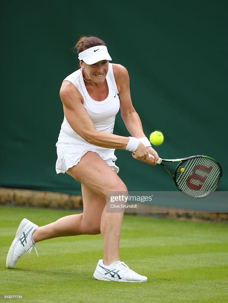<a gi-track='captionPersonalityLinkClicked' href=/galleries/search?phrase=Madison+Brengle&family=editorial&specificpeople=4110556 ng-click='$event.stopPropagation()'>Madison Brengle</a> of The United States plays a backhand shot during the Ladies Singles first round match against Kurumi Nara of Japan on day one of the Wimbledon Lawn Tennis Championships at the All England Lawn Tennis and Croquet Club on June 27th, 2016 in London, England.