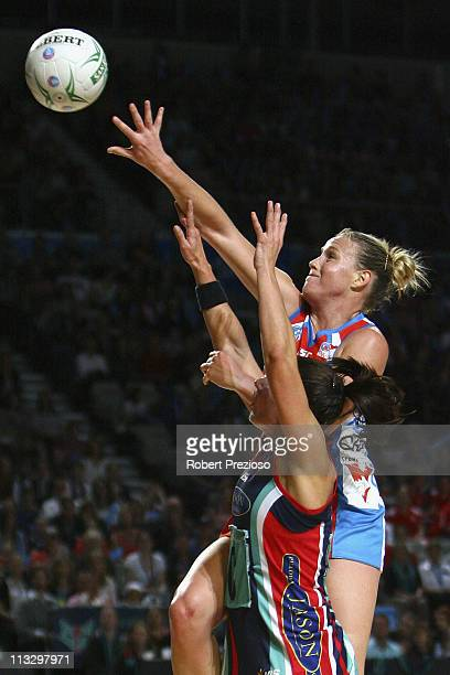 Madison Browne of the Vixens and Kimberlee Green contest the ball during the round 12 ANZ Championship match between the Melbourne Vixens and the...