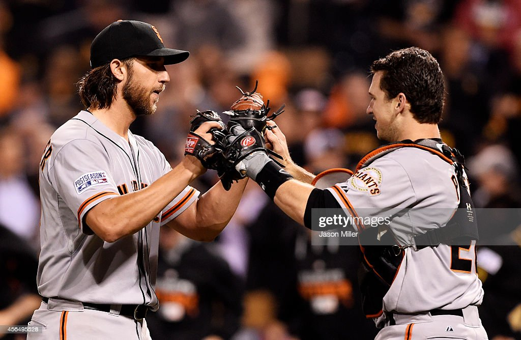 <a gi-track='captionPersonalityLinkClicked' href=/galleries/search?phrase=Madison+Bumgarner&family=editorial&specificpeople=5974095 ng-click='$event.stopPropagation()'>Madison Bumgarner</a> #40 and <a gi-track='captionPersonalityLinkClicked' href=/galleries/search?phrase=Buster+Posey&family=editorial&specificpeople=4896435 ng-click='$event.stopPropagation()'>Buster Posey</a> #28 of the San Francisco Giants celebrate their 8 to 0 win over the Pittsburgh Pirates during the National League Wild Card game at PNC Park on October 1, 2014 in Pittsburgh, Pennsylvania.
