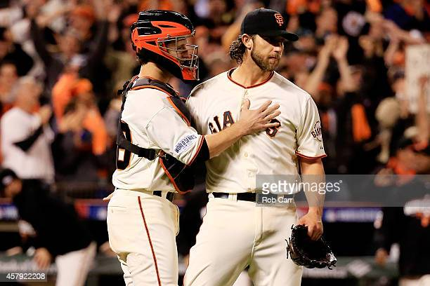 Madison Bumgarner celebrates with Buster Posey of the San Francisco Giants after defeating the Kansas City Royals 50 in Game Five of the 2014 World...