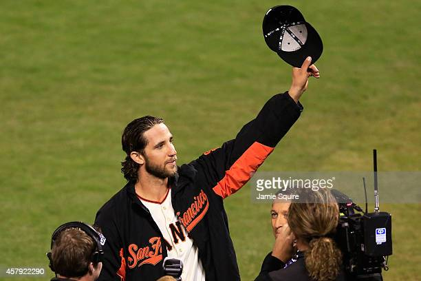 Madison Bumgarner of the San Francisco Giants acknowledges the crowd after defeating the Kansas City Royals 50 in Game Five of the 2014 World Series...