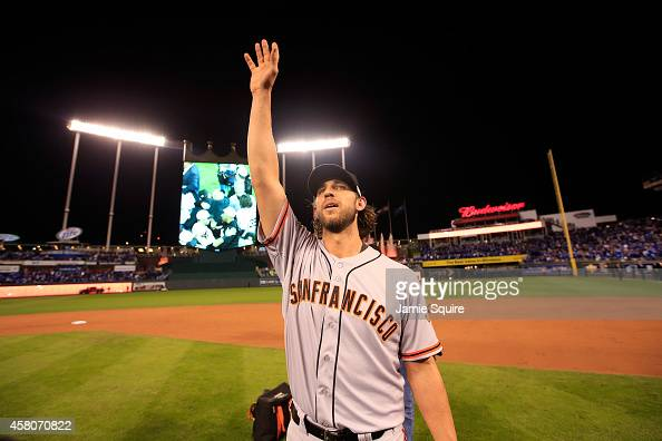 Madison Bumgarner of the San Francisco Giants acknowledges the crowd after defeating the Kansas City Royals to win Game Seven of the 2014 World...