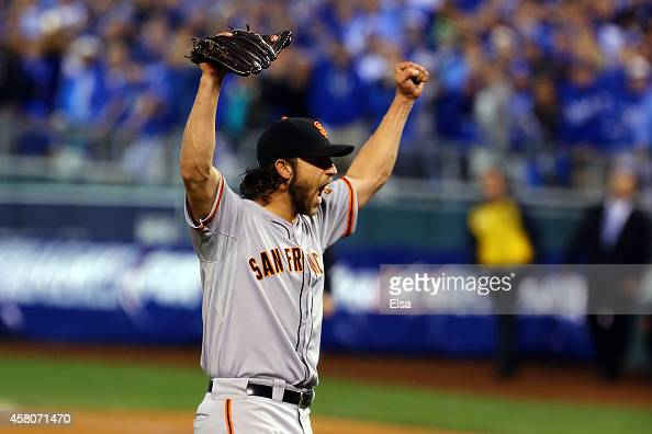 Madison Bumgarner of the San Francisco Giants celebrates after defeating the Kansas City Royals to win Game Seven of the 2014 World Series by a score...