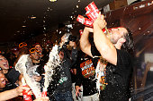 Madison Bumgarner of the San Francisco Giants celebrates in the locker room after their 3 to 2 win over the Washington Nationals in Game Four of the...