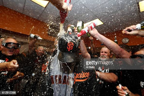 Madison Bumgarner of the San Francisco Giants celebrates their 30 victory over the New York Mets in the locker room after their National League Wild...