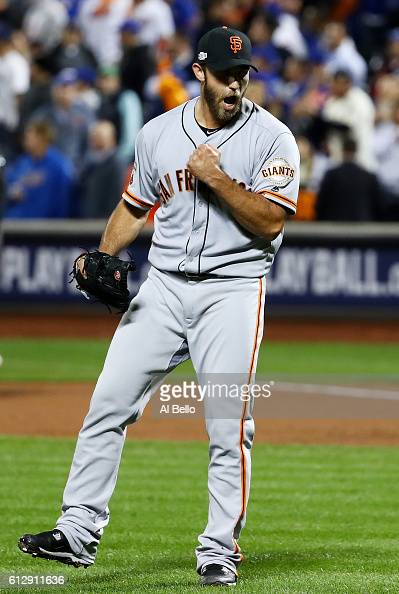 Madison Bumgarner of the San Francisco Giants celebrates their 30 win over the New York Mets during their National League Wild Card game at Citi...