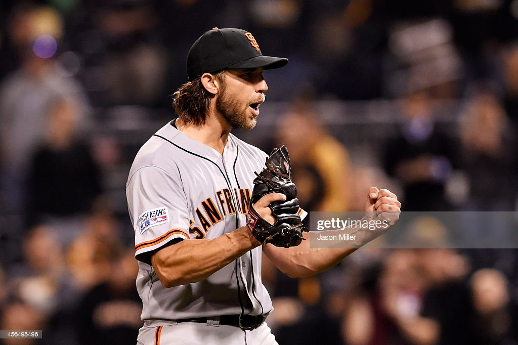 Madison Bumgarner of the San Francisco Giants celebrates their 8 to 0 win over the Pittsburgh Pirates during the National League Wild Card game at...