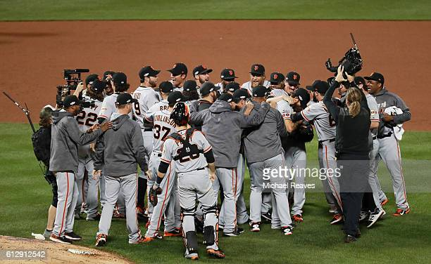 Madison Bumgarner of the San Francisco Giants celebrates with teammates after they defeated the New York Mets 30 to win the National League Wild Card...