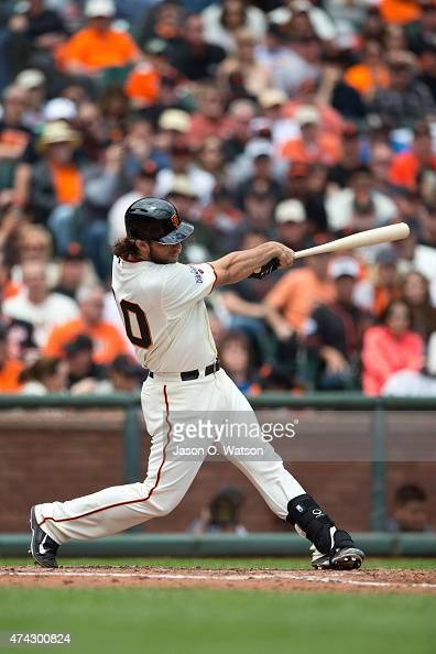 Madison Bumgarner of the San Francisco Giants hits a home run against the Los Angeles Dodgers during the third inning at ATT Park on May 21 2015 in...