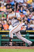 Madison Bumgarner of the San Francisco Giants hits a home run in the second inning during the game against the Pittsburgh Pirates at PNC Park on...