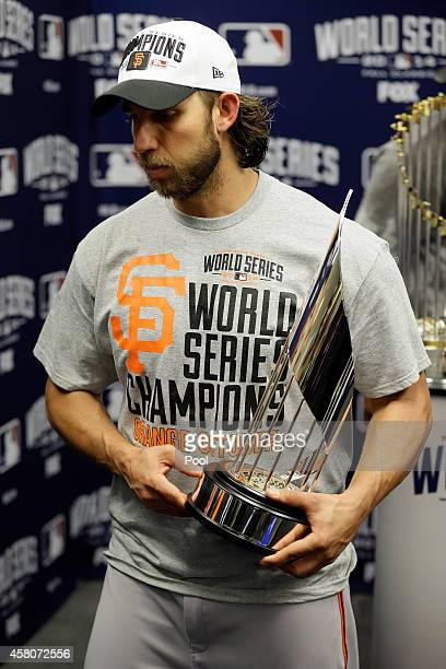 Madison Bumgarner of the San Francisco Giants holds the MVP trophy following a 32 victory over the Kansas City Royals in Game Seven of the 2014 World...