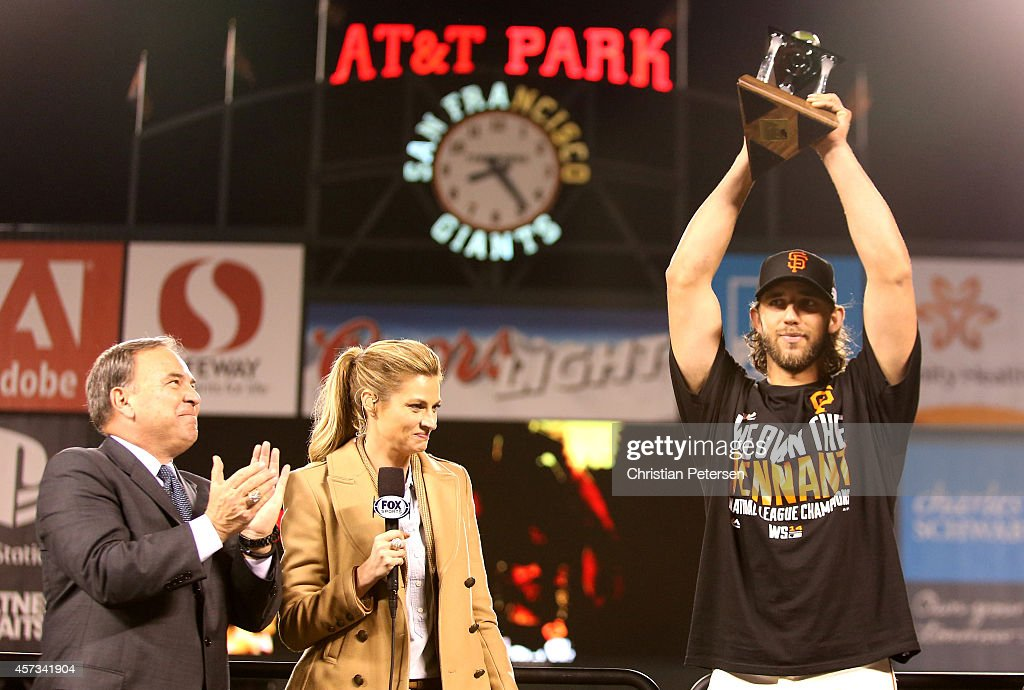 Madison Bumgarner #40 of the San Francisco Giants holds up the NLCS MVP award after the Giants defeat the St. Louis Cardinals 6-3 during Game Five of the National League Championship Series at AT&T Park on October 16, 2014 in San Francisco, California.