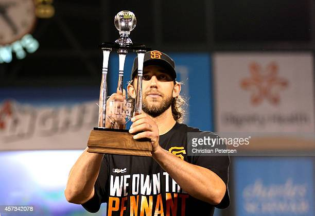 Madison Bumgarner of the San Francisco Giants holds up the NLCS MVP award after the Giants defeat the St Louis Cardinals 63 during Game Five of the...
