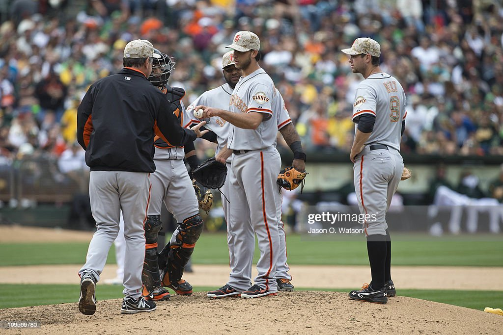 Madison Bumgarner #40 of the San Francisco Giants is relieved by manager Bruce Bochy #15 during the seventh inning against the Oakland Athletics in an interleague game at O.co Coliseum on May 27, 2013 in Oakland, California.
