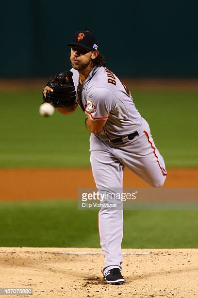 Madison Bumgarner of the San Francisco Giants pitches in the first inning against the St Louis Cardinals during Game One of the National League...
