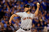 Madison Bumgarner of the San Francisco Giants pitches in the first inning against the Kansas City Royals during Game One of the 2014 World Series at...
