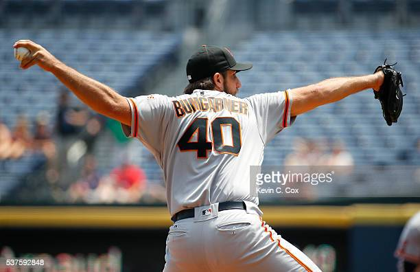 Madison Bumgarner of the San Francisco Giants pitches in the first inning against the Atlanta Braves at Turner Field on June 2 2016 in Atlanta Georgia