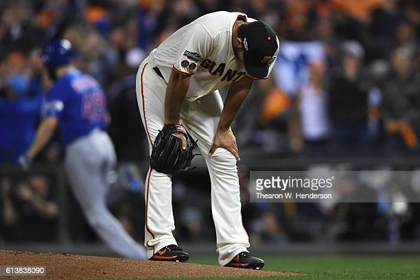 Madison Bumgarner of the San Francisco Giants reacts after allowing a threerun home run to Jake Arrieta of the Chicago Cubs during Game Three of...