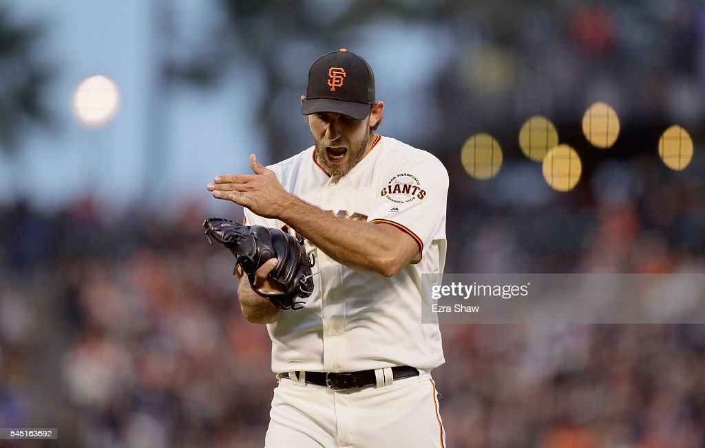 Madison Bumgarner #40 of the San Francisco Giants reacts after Mac Williamson #51 of the San Francisco Giants caught a fly ball hit by Trevor Story #27 of the Colorado Rockies that ended the third inning with the bases loaded at AT&T Park on July 5, 2016 in San Francisco, California.