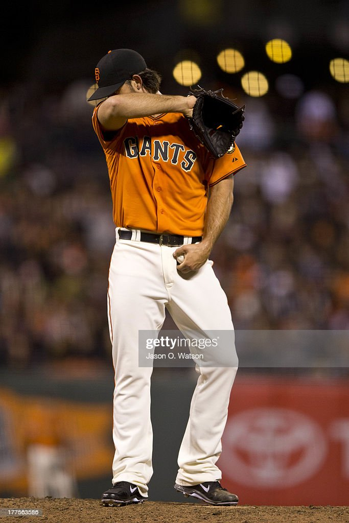 <a gi-track='captionPersonalityLinkClicked' href=/galleries/search?phrase=Madison+Bumgarner&family=editorial&specificpeople=5974095 ng-click='$event.stopPropagation()'>Madison Bumgarner</a> #40 of the San Francisco Giants reacts after walking Russell Martin of the Pittsburgh Pirates (not pictured) during the eighth inning at AT&T Park on August 23, 2013 in San Francisco, California.