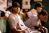 Madison Bumgarner of the San Francisco Giants sits in the dugout during their National League Wild Card game against the Pittsburgh Pirates at PNC...