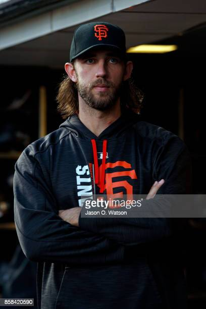 Madison Bumgarner of the San Francisco Giants stands in the dugout before the game against the San Diego Padres at ATT Park on September 29 2017 in...