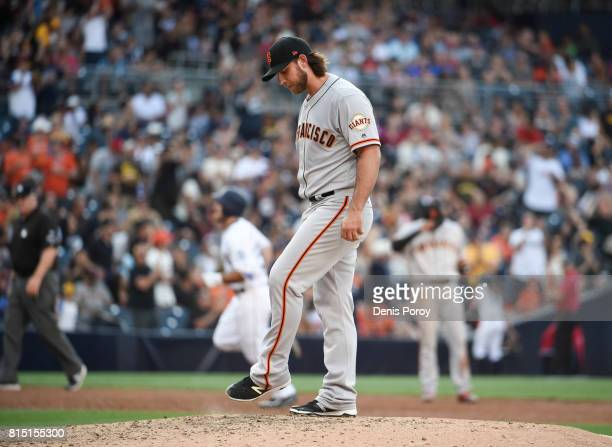 Madison Bumgarner of the San Francisco Giants stands on the mound after giving up a solo home run to Matt Szczur of the San Diego Padres during the...