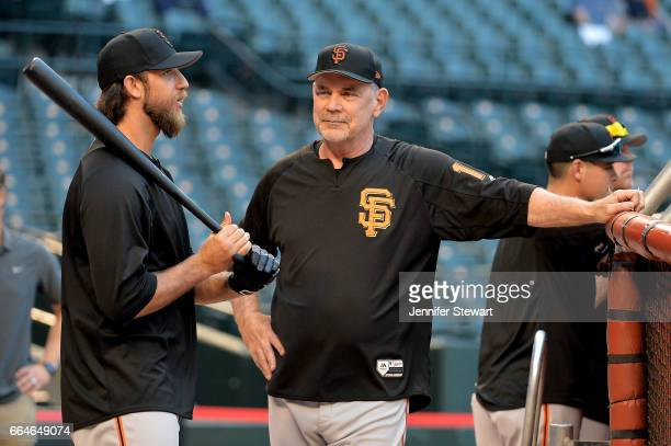 Madison Bumgarner of the San Francisco Giants talks with manager Bruce Bochy prior to the MLB game against the Arizona Diamondbacks at Chase Field on...