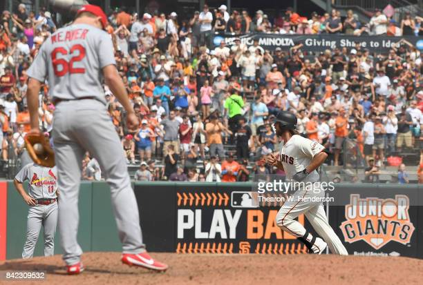 Madison Bumgarner of the San Francisco Giants trots around the bases after hitting a solo home run off of Luke Weaver of the St Louis Cardinals in...