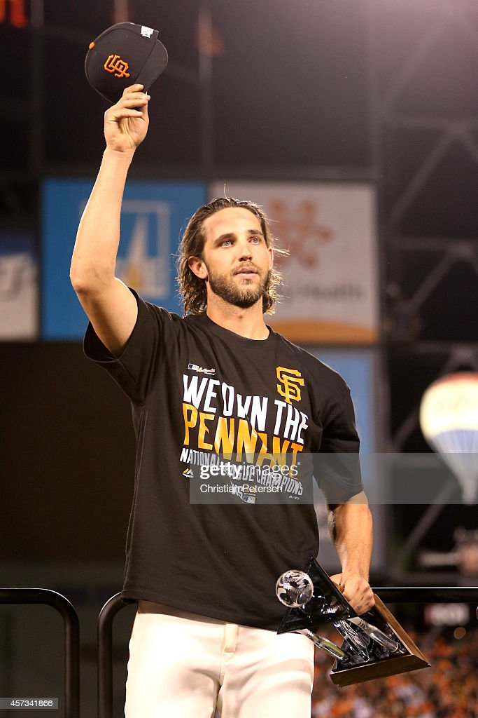 Madison Bumgarner #40 of the San Francisco Giants waves to the crowd with the NLCS MVP award after the Giants defeat the St. Louis Cardinals 6-3 during Game Five of the National League Championship Series at AT&T Park on October 16, 2014 in San Francisco, California.