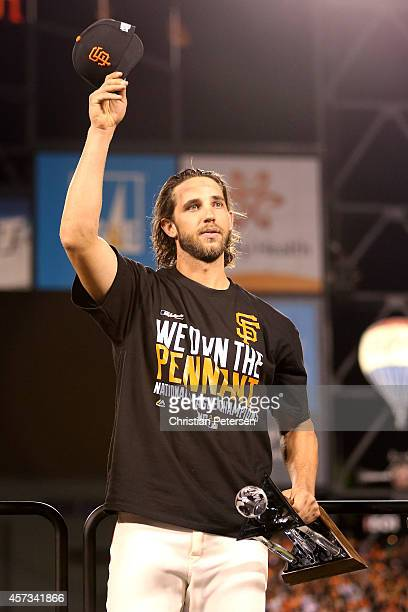 Madison Bumgarner of the San Francisco Giants waves to the crowd with the NLCS MVP award after the Giants defeat the St Louis Cardinals 63 during...