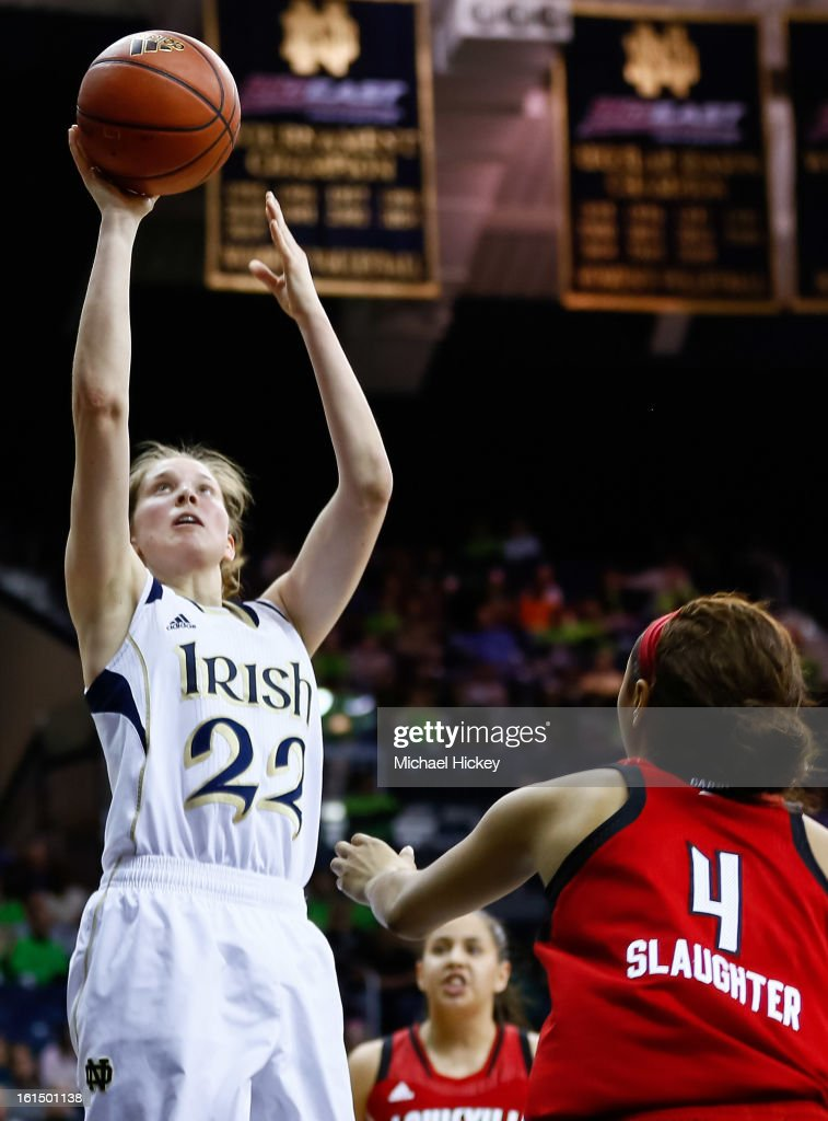 Madison Cable #22 of the Notre Dame Fighting Irish shoots the ball against Antonita Slaughter #4 of the Louisville Cardinals at Purcel Pavilion on February 11, 2013 in South Bend, Indiana. Notre Dame defeated Louisville 93-64.