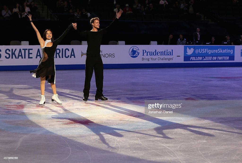 Madison Chock and Evan Bates acknowledge the crowd after winning the Ice Dance Free Dance during the 2014 Hilton HHonors Skate America competition at...