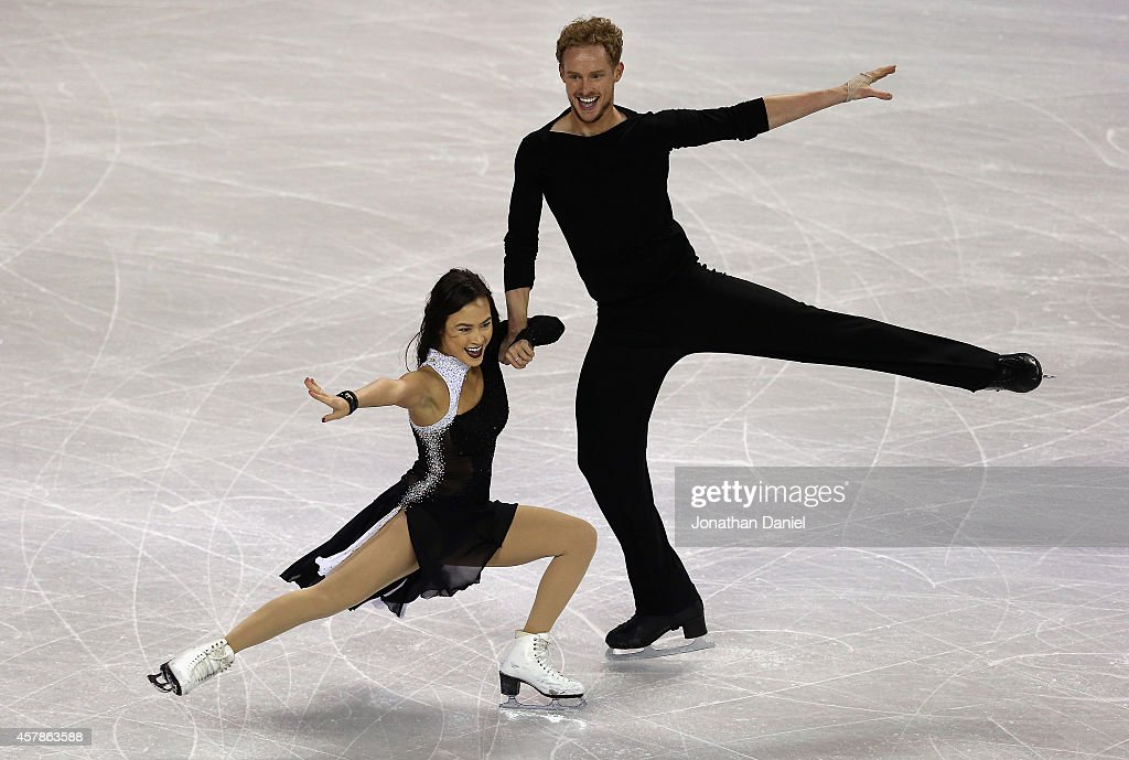 Madison Chock and Evan Bates compete in the Ice Dance Free Dance during the 2014 Hilton HHonors Skate America competition at the Sears Centre Arena...