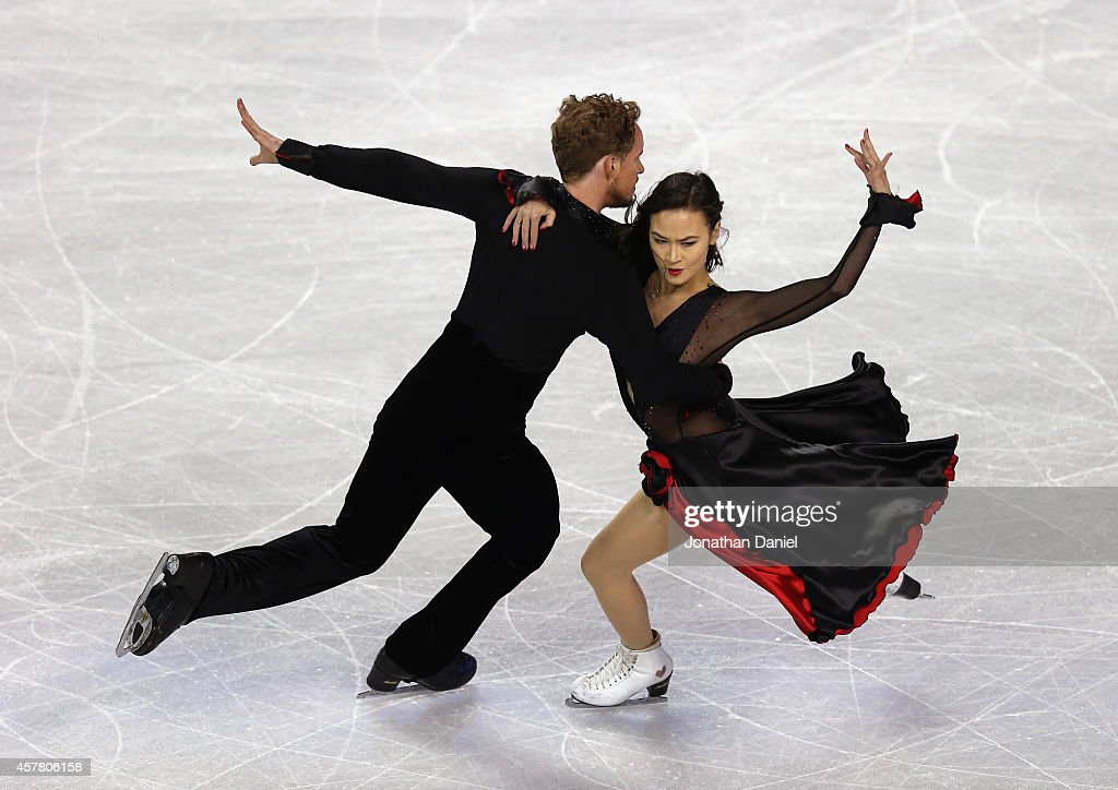 Madison Chock and Evan Bates compete in the ice Dance Short Dance during the 2014 Hilton HHonors Skate America competition at the Sears Centre Arena...
