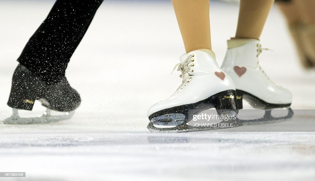 Madison Chock and Evan Bates of the US perform during a practice session for their Ice Dance short program of the 2015 ISU World Figure Skating...