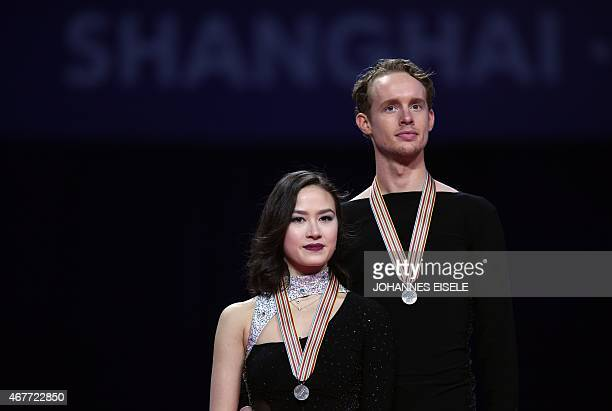 Madison Chock and Evan Bates of the US pose with their silver medals during the award ceremony of the ice dance of the 2015 ISU World Figure Skating...